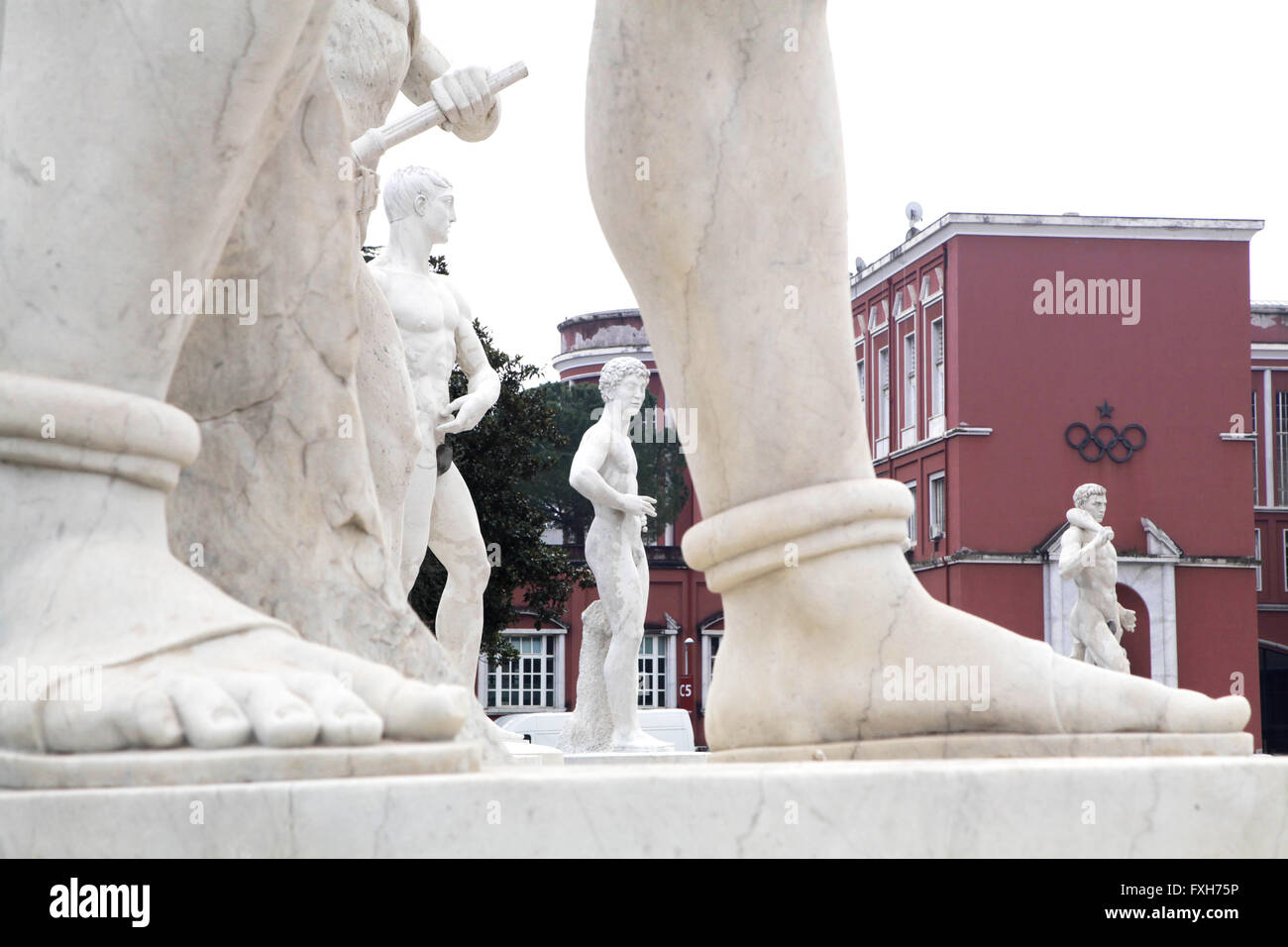 Italian Olympic Committee aka CONI. Statue of athlete in Stadio dei Marmi. Stadium of the Marbles a sport complex - Stock Image