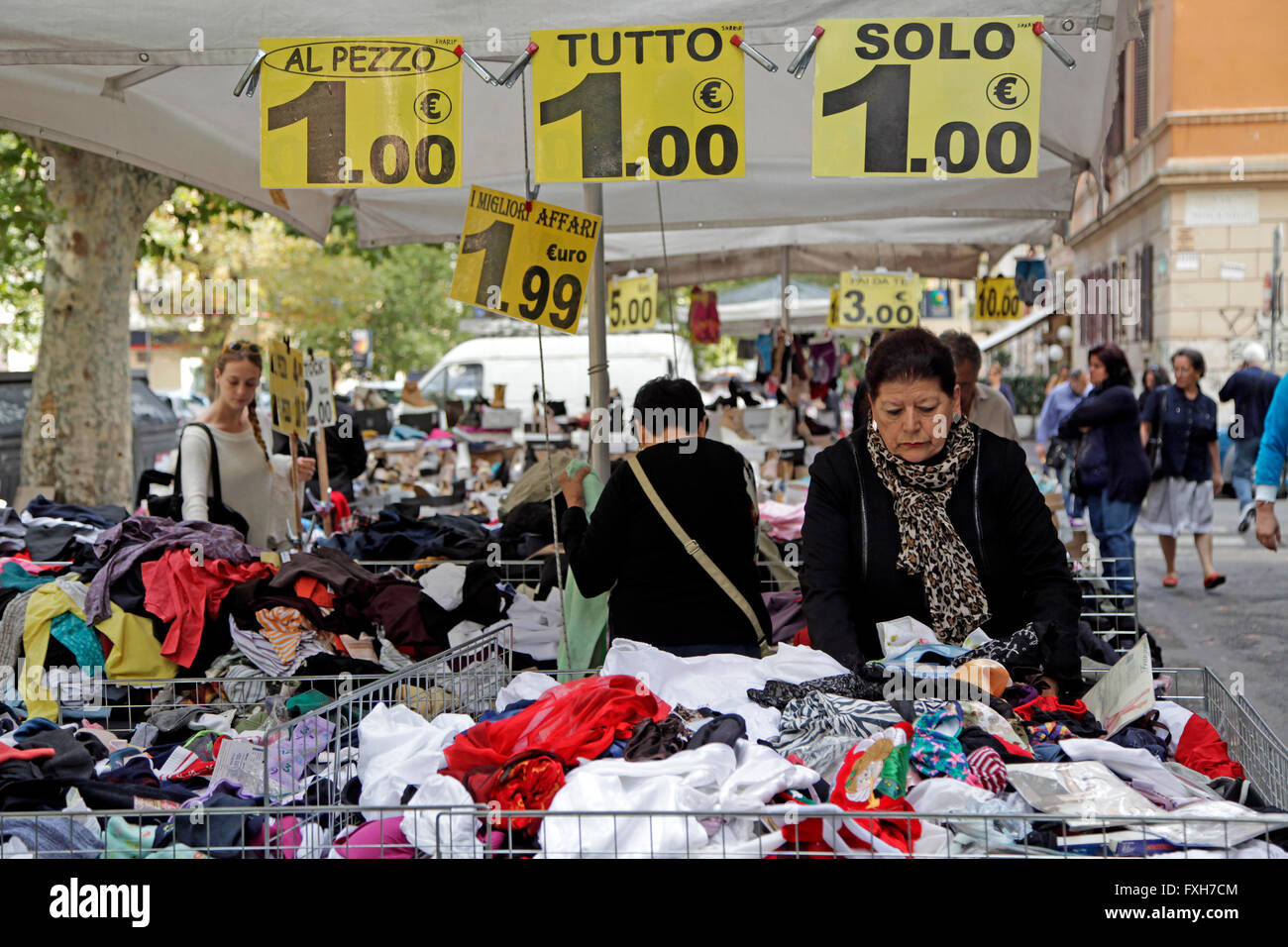 Price signs display the cost in euros of clothes on a stall at an outdoor market in Rome, Italy - Stock Image