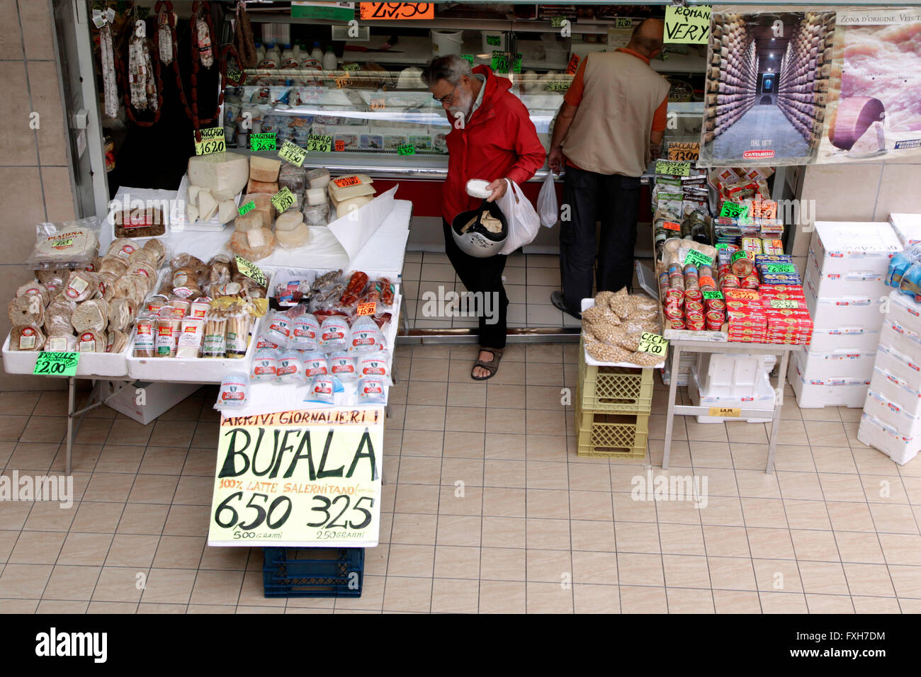 Signs display the price in euros of italian cheese inside an indoor market in Rome, Italy - Stock Image