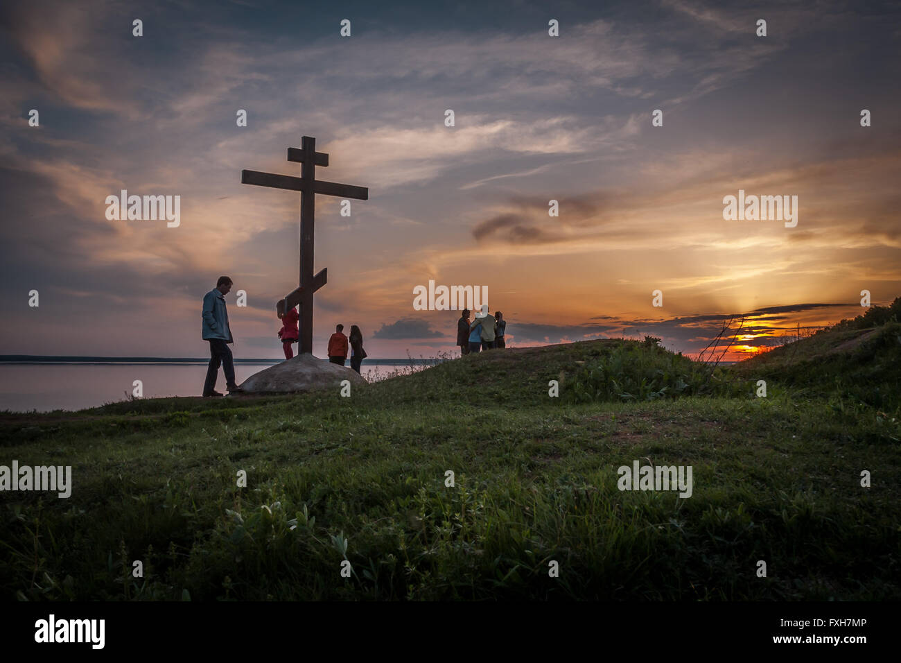 These carefree tourists don't even know, in how many million lives Christianization of Russia has managed. And - Stock Image