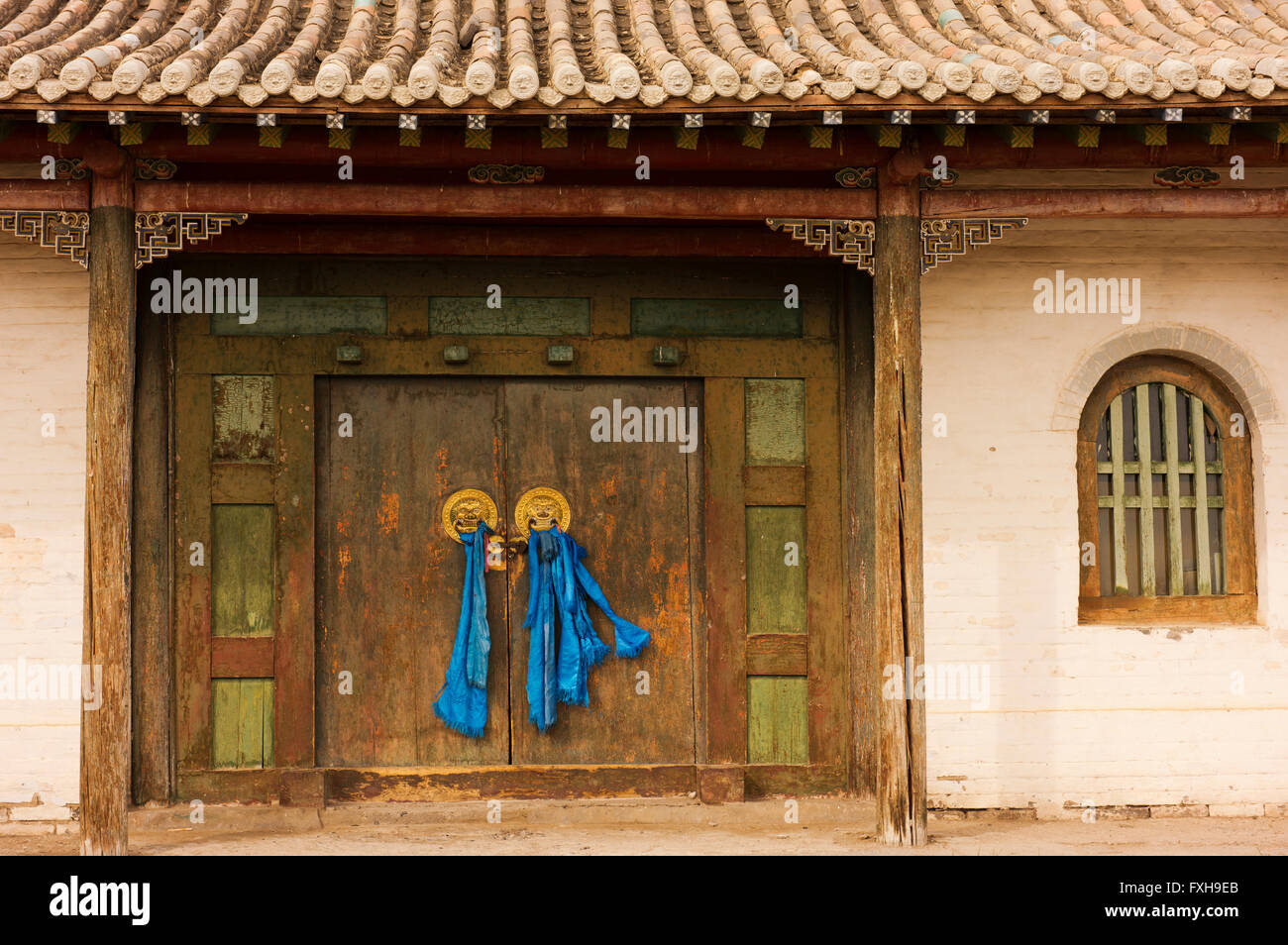 Doors with traditional pale blue sashes at the Erdene Zuu Monastery in Ovorkhangai Province. - Stock Image