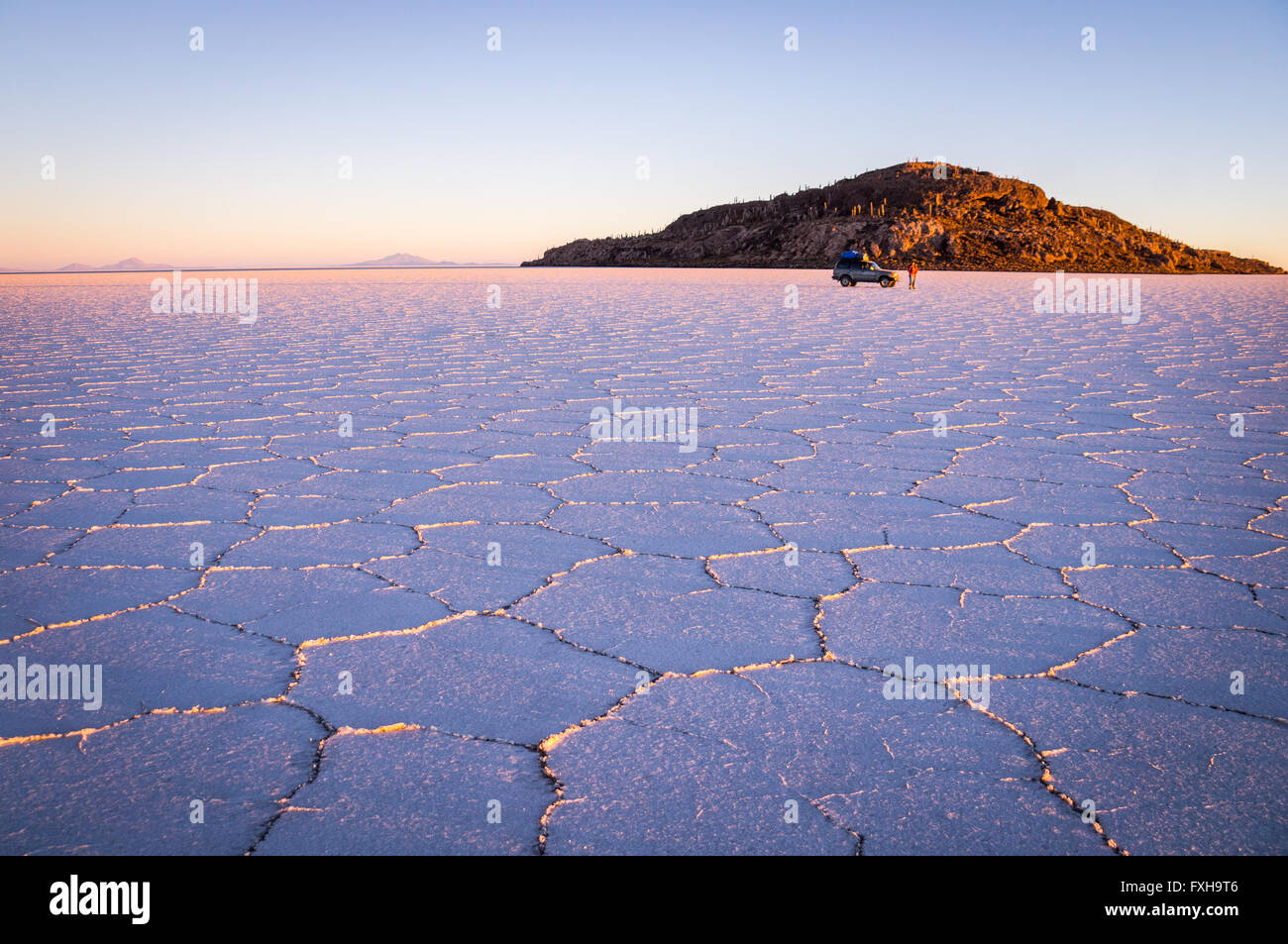 Salar Uyuni, BOLIVIA in September 2015: The sun rises over worlds largest salt lake Salar de Uyuni. Southwestern - Stock Image
