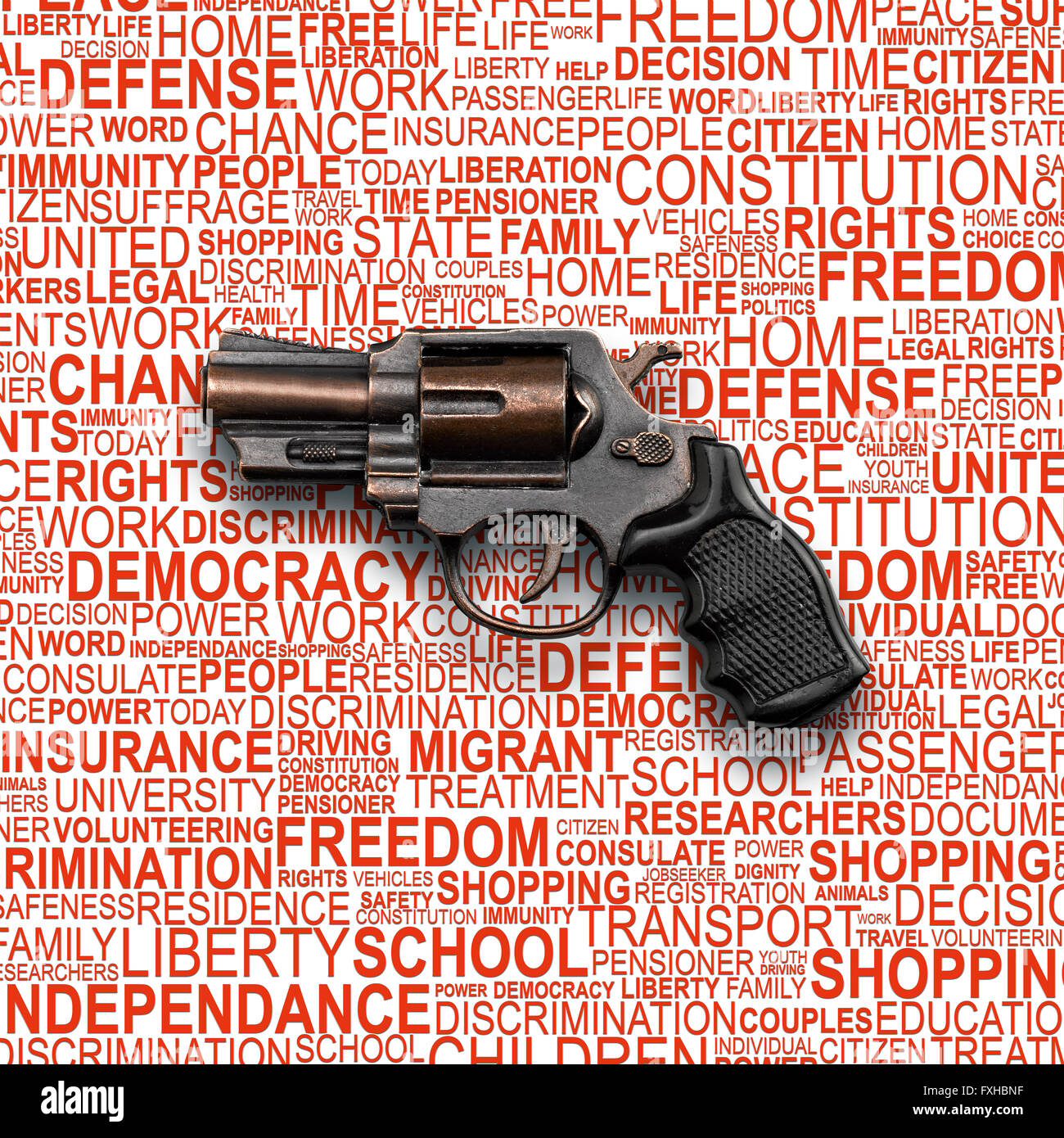 Revolver Gun, toy for children with background concept wordcloud of human rights - Stock Image