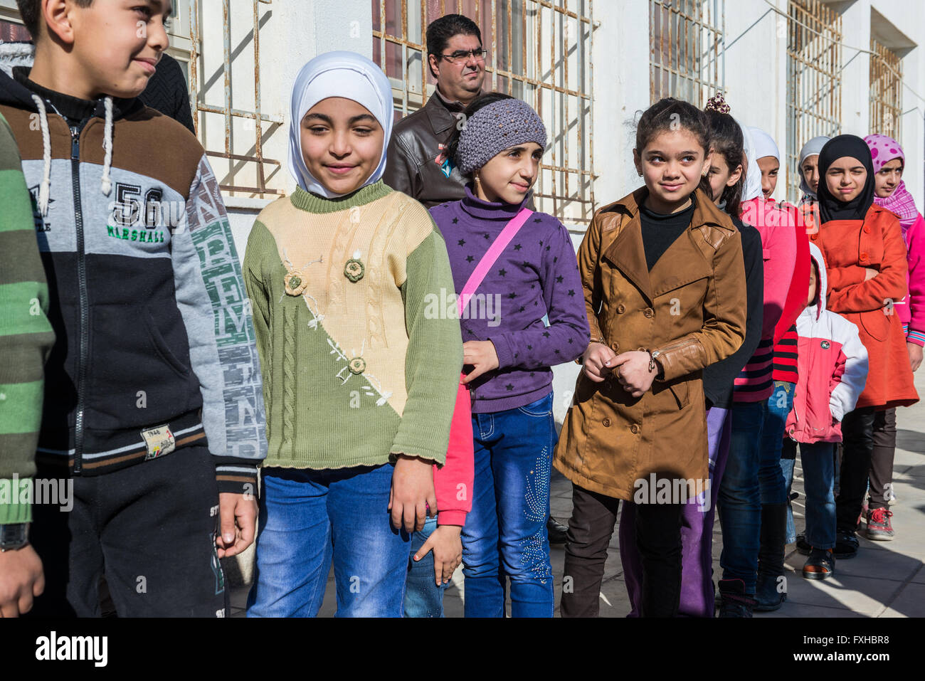 Pupils in school both for Jordan kids and Syrian refugees children in Ar Ramtha city, Jordan, 10 km from Syrian Stock Photo
