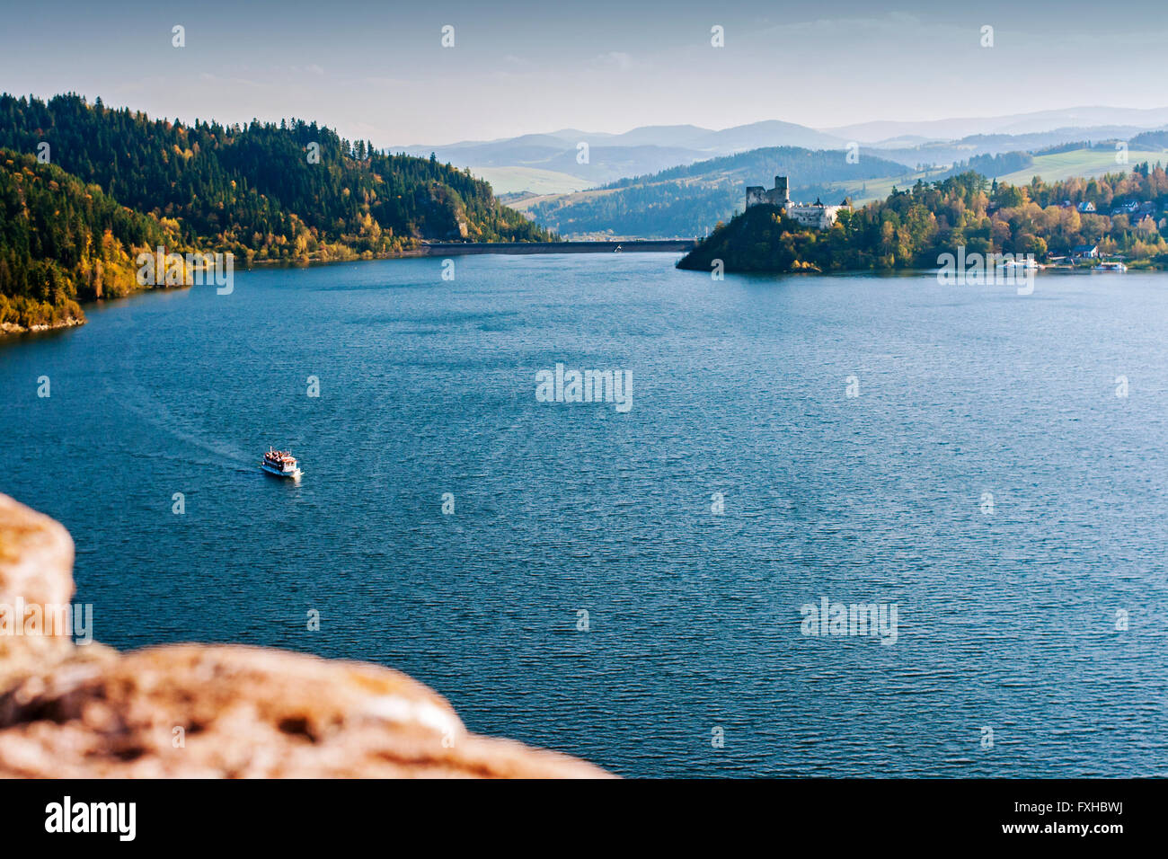 Lonely boat on the calm lake among the Pieniny mountains in Poland - Stock Image