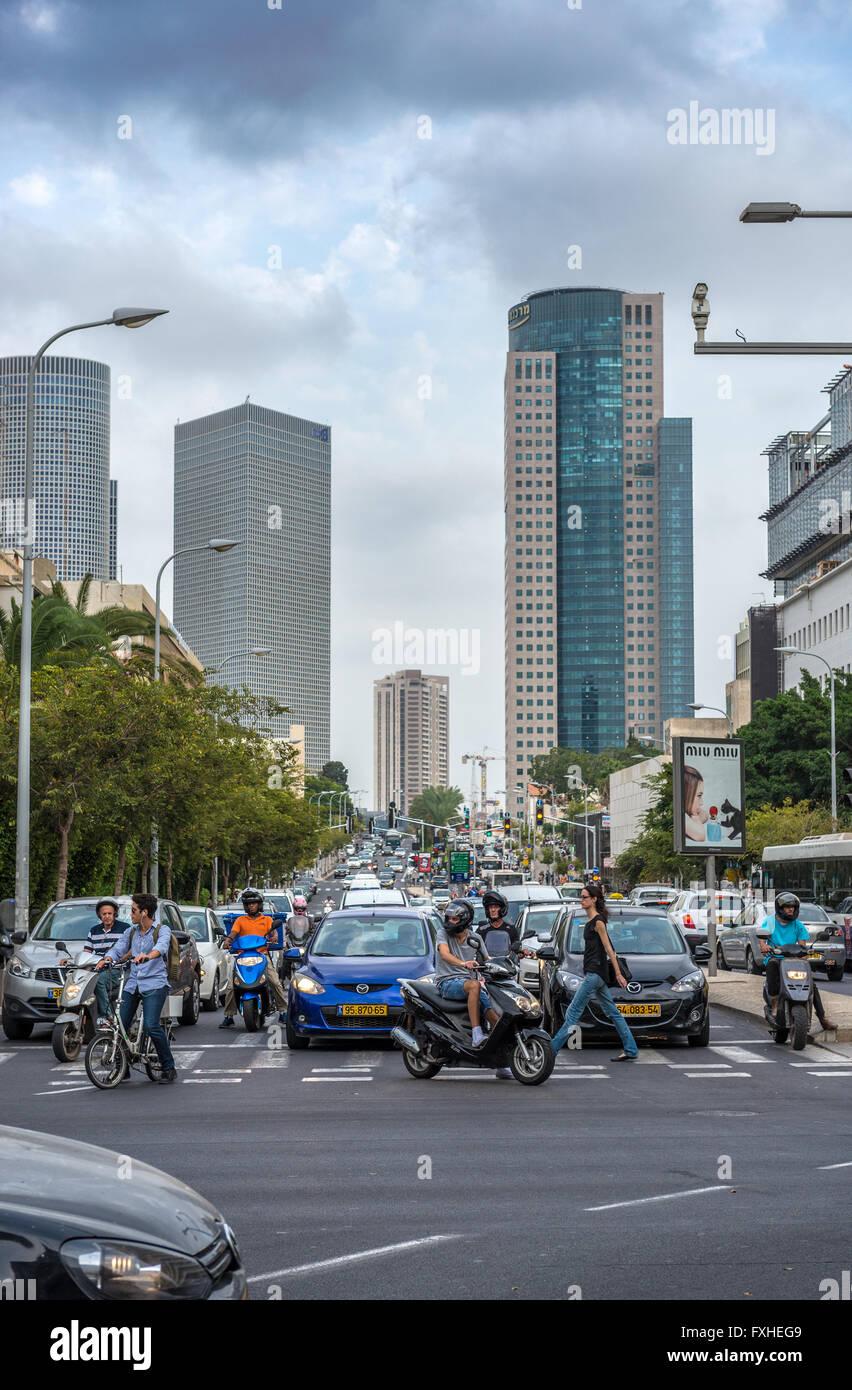 Eliezer Kaplan anr Ibn Gabirol Streets in Tel Aviv, Israel. Azrieli Center Towers (left) and Kirya Tower (right) - Stock Image