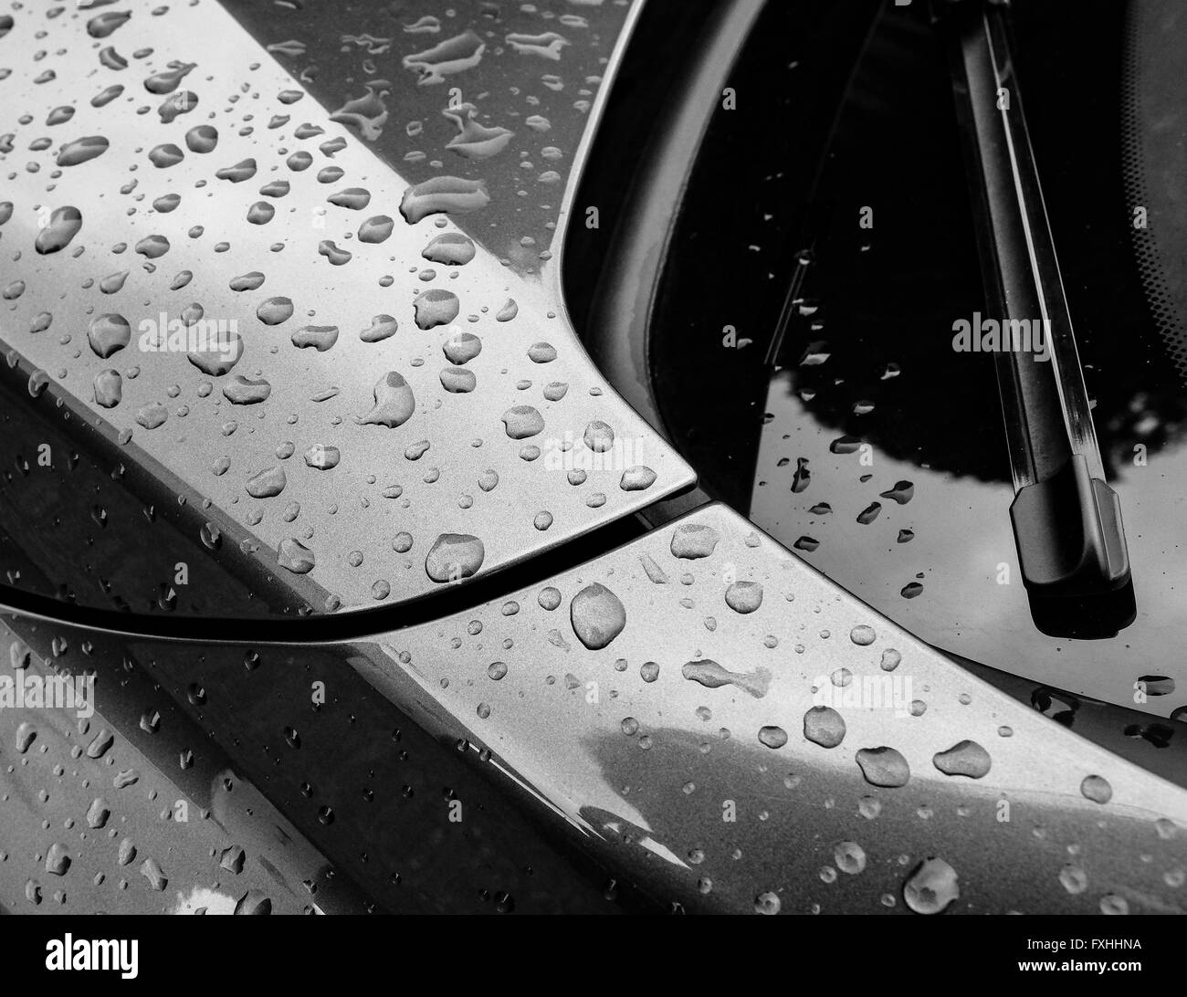 Droplets of water on the body of a new BMW sports car. - Stock Image