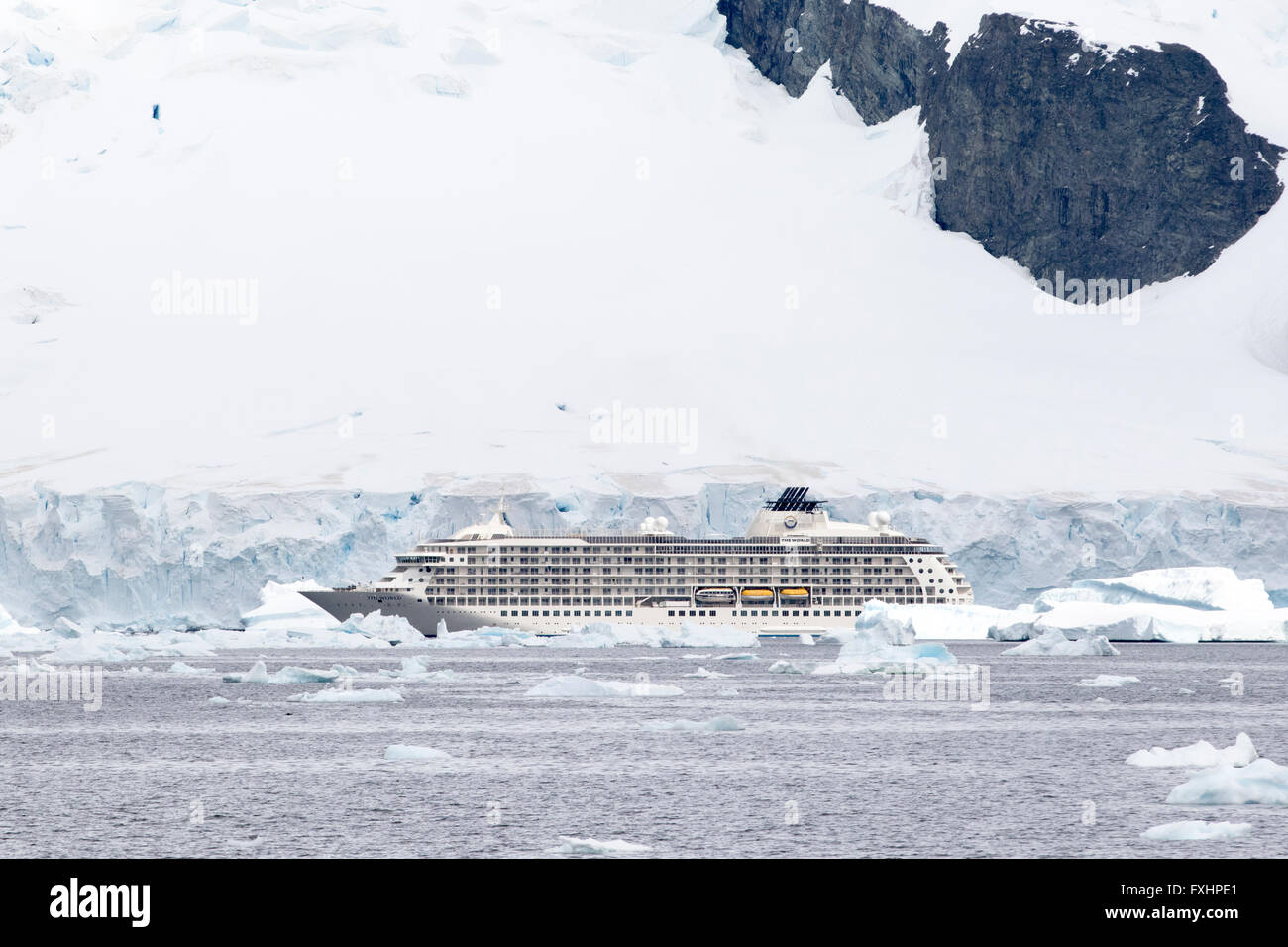 The World cruise ship in Antarctica with icebergs and glacier. - Stock Image