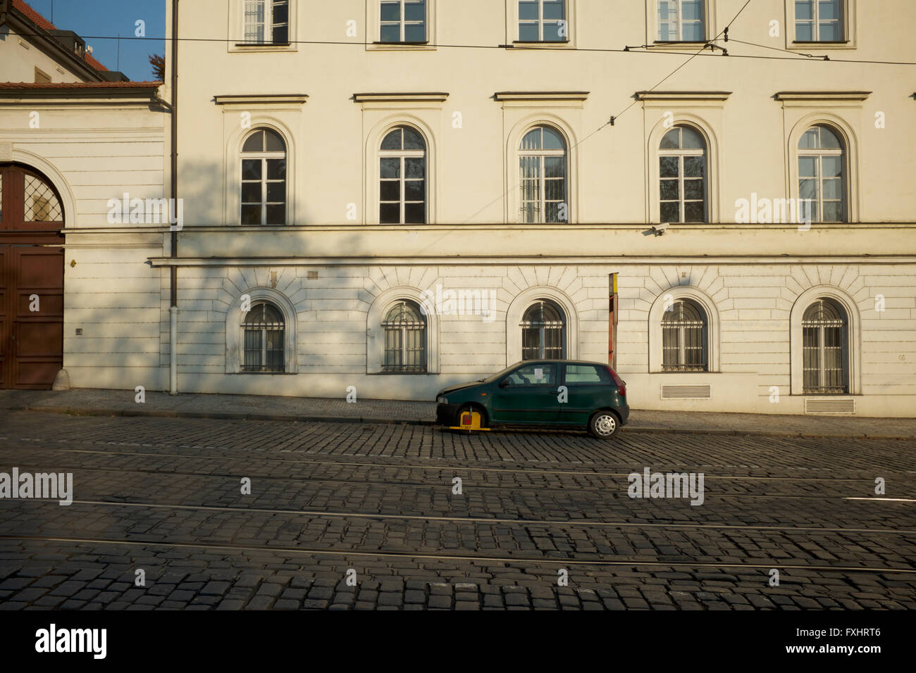 A wheelclamped car in Prague - Stock Image