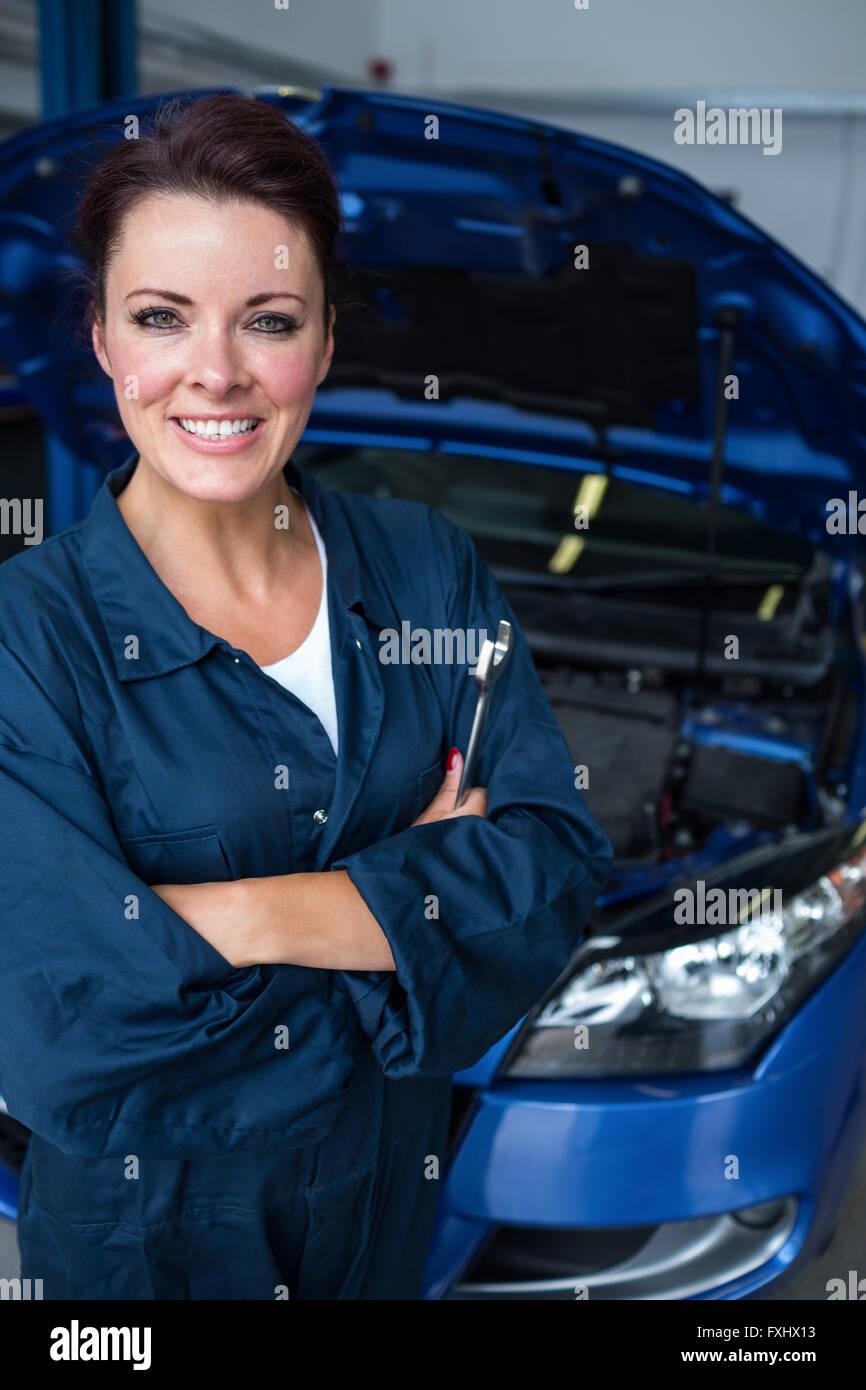 Female mechanic holding spanner - Stock Image