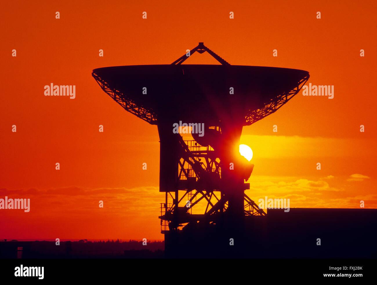 Sunset over telecommunications satellite dish near Cornwall: England - Stock Image