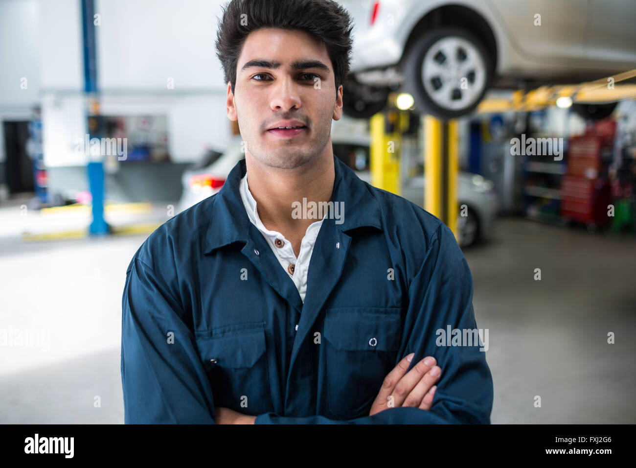 Mechanic with arms crossed - Stock Image