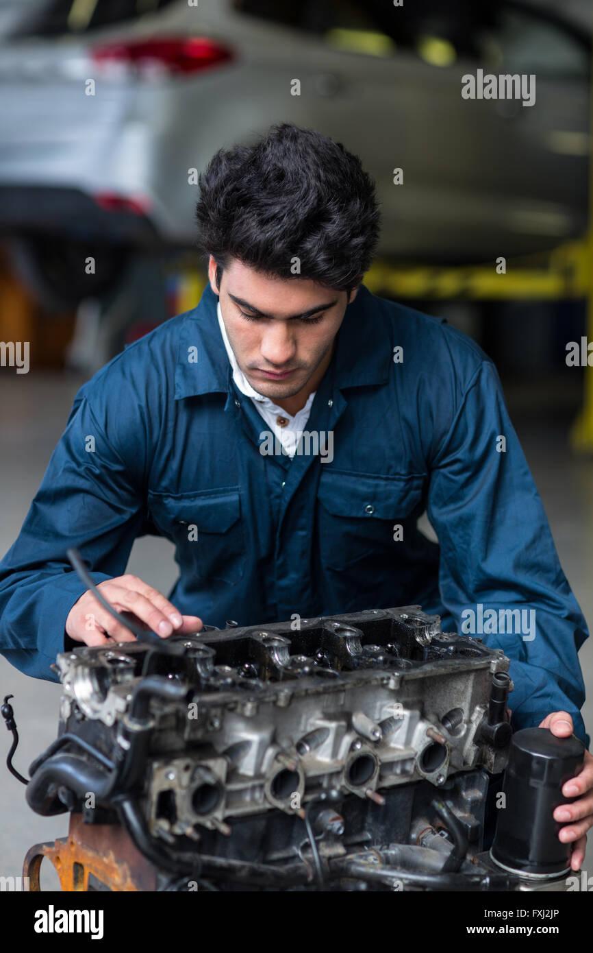 Mechanic working on an engine - Stock Image