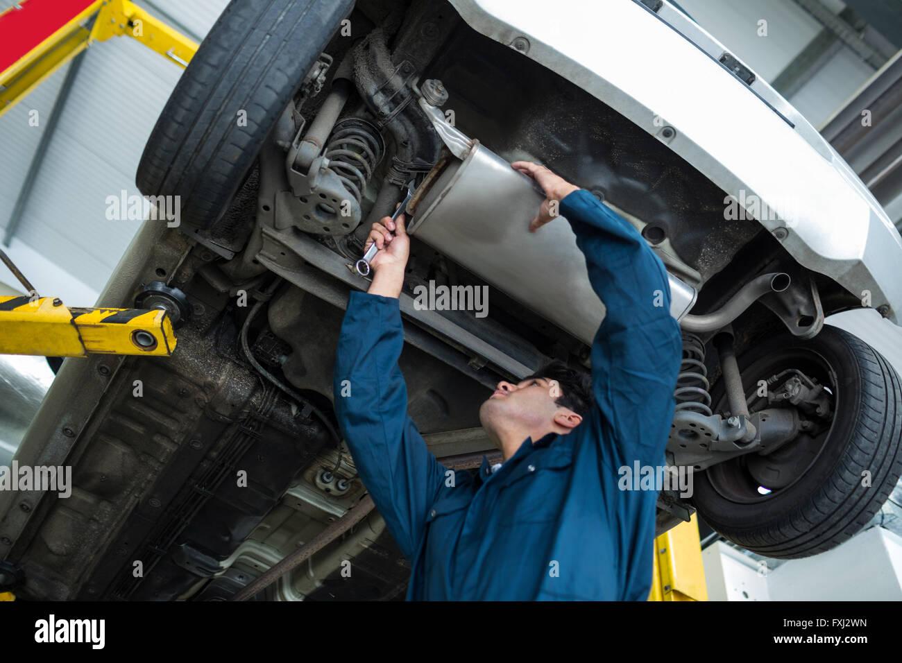 Mechanic repairing a car - Stock Image