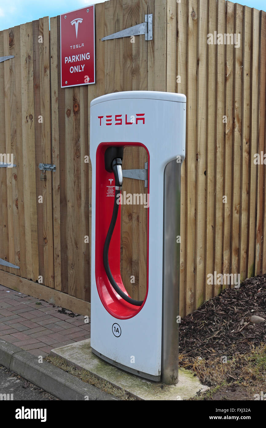 Tesla car charging point at Gretna motorway services in a parking bay for Tesla cars only - Stock Image
