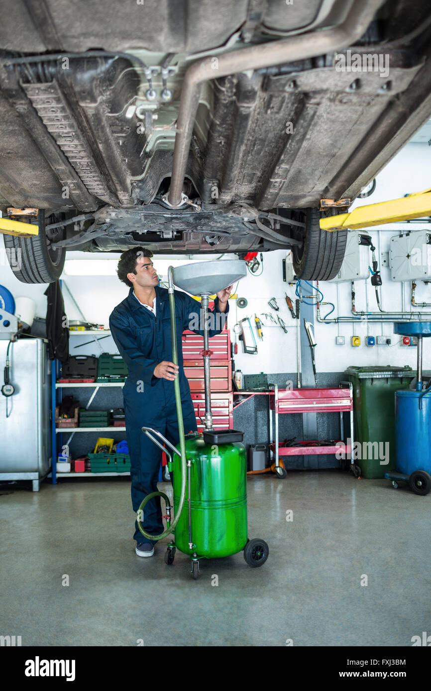Mechanic servicing a car - Stock Image