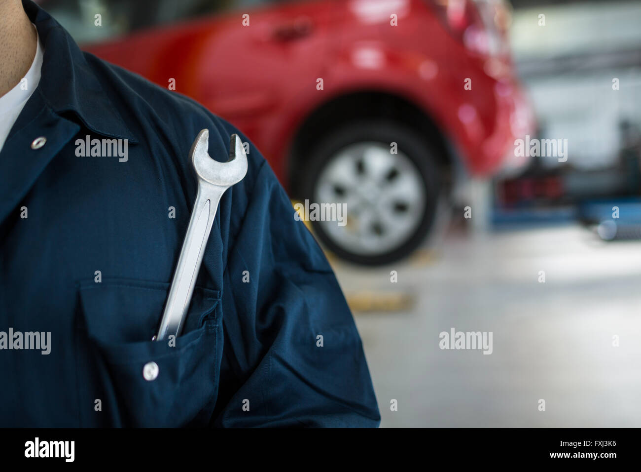 Mechanic with spanner - Stock Image