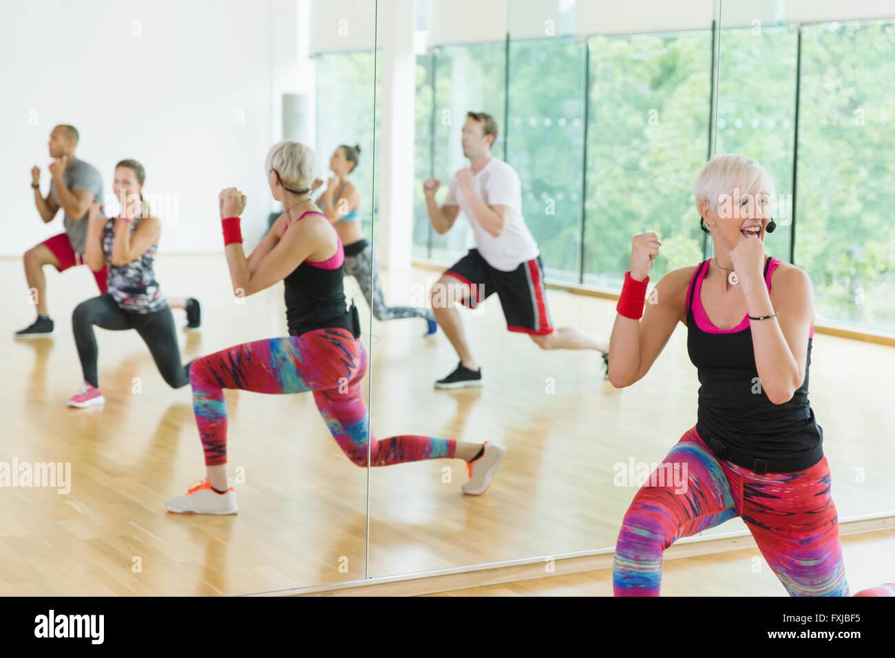 Fitness instructor leading aerobics class Stock Photo