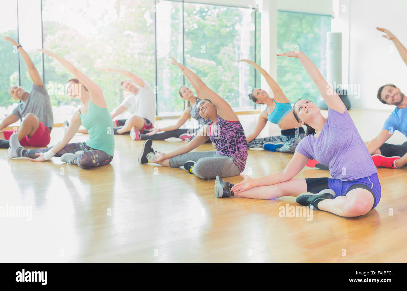 Exercise class stretching arms - Stock Image