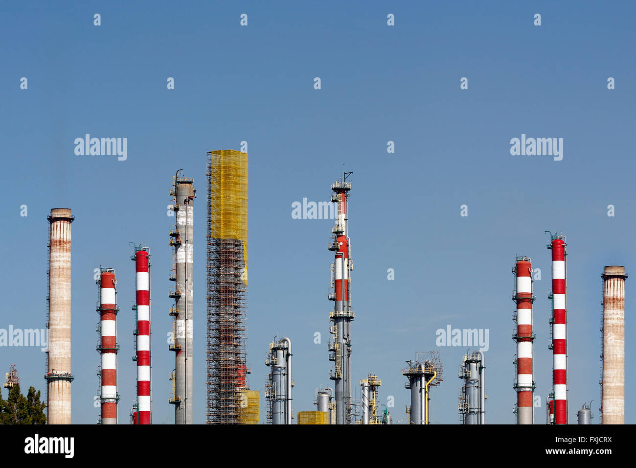 Chimneys in a large oil refinery - Stock Image
