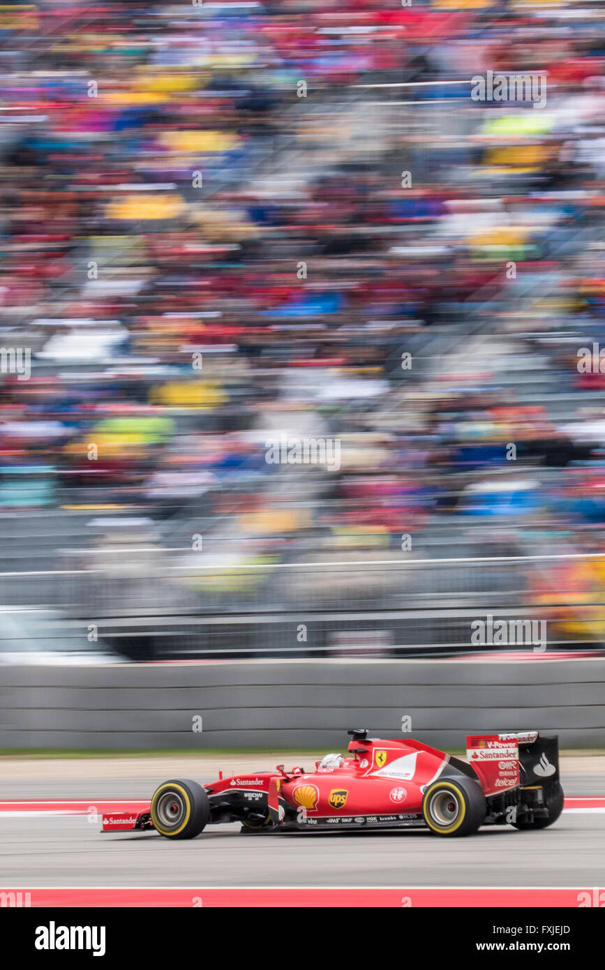 Sebastian Vettel of Ferrari races past the grandstand at turn 15 of Circuit of the Americas during the 2015 US Grand Stock Photo