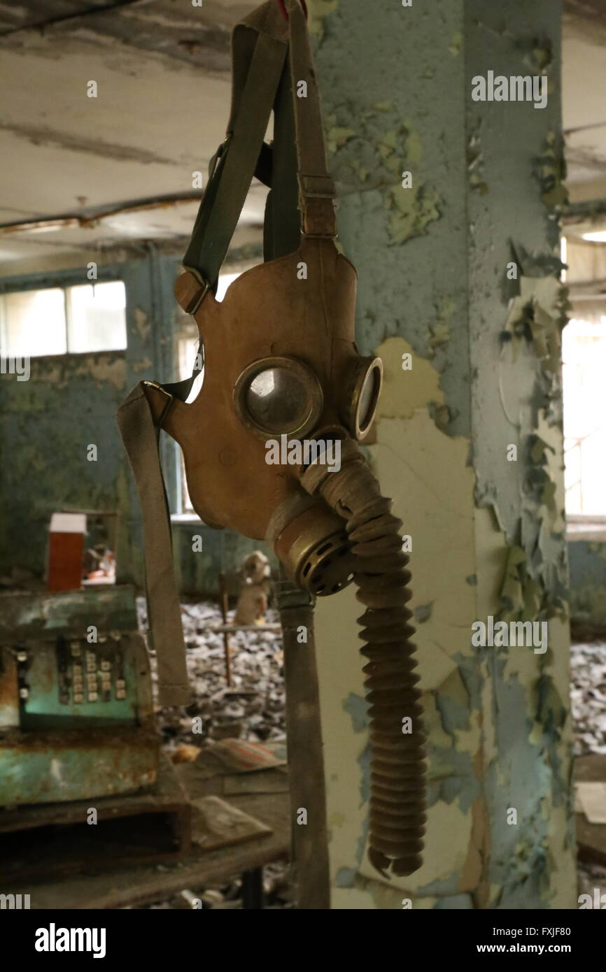 Gas mask in the abandoned city of Pripyat, Chernobyl Exclusion Zone, Ukraine - Stock Image