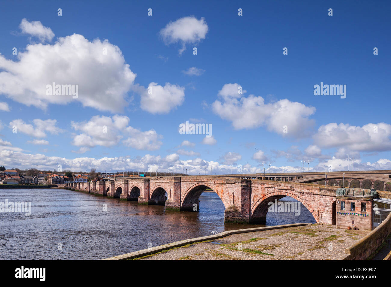 Berwick Old Bridge on the River Tweed, and beyond it the Royal Tweed Bridge, Berwick-upon-Tweed, Northumberland, - Stock Image