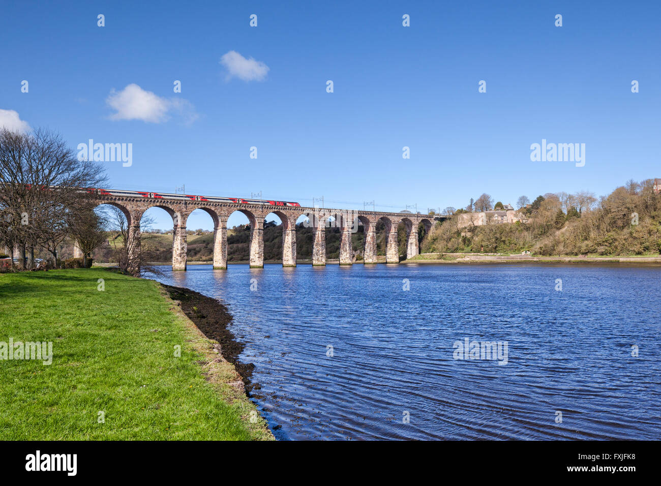 Virgin Train crossing the viaduct over the River Tweed at Berwick-upon-Tweed, Northumberland, England, UK - Stock Image