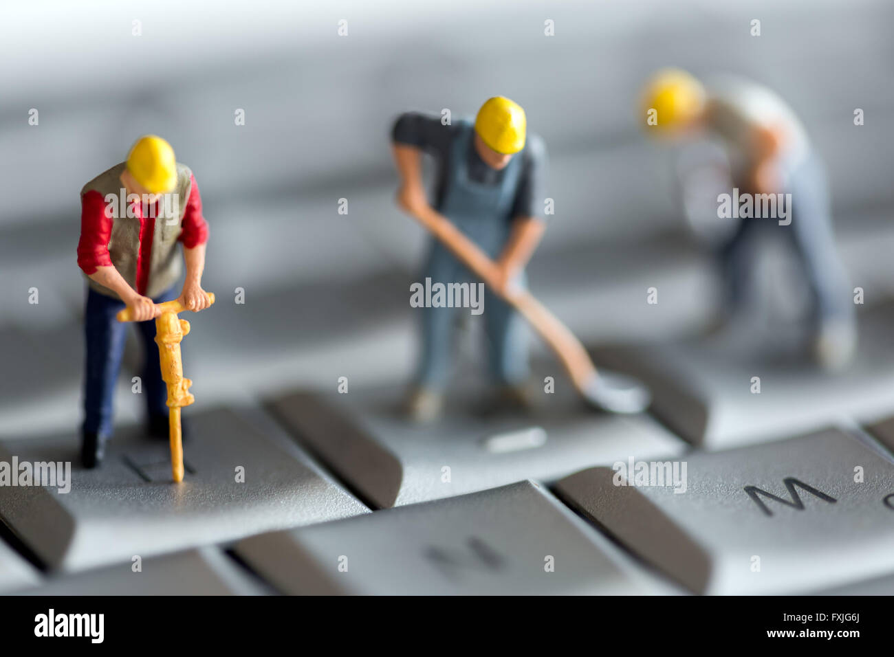 Close up concept stock photo depicting data mining or theft of computer information. - Stock Image