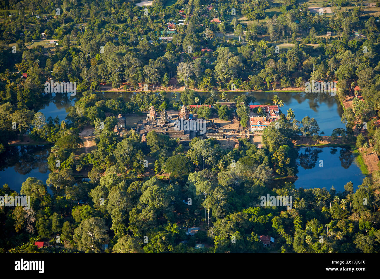 Moat and Bakong temple ruins (from 9th century AD), in Roluos Temple Group, Angkor World Heritage Site, near Siem - Stock Image