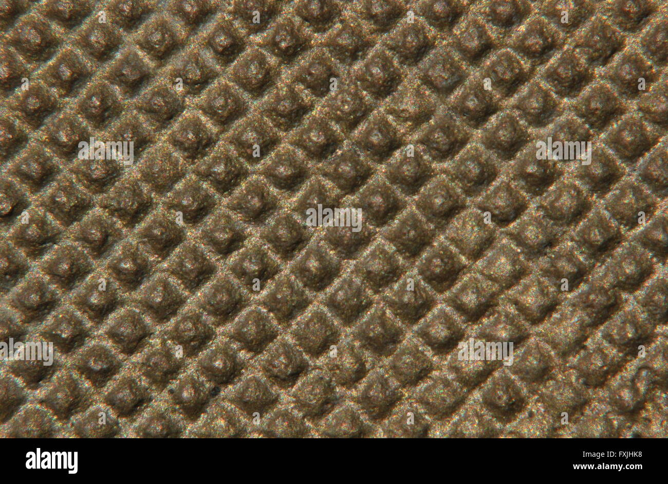 Close-up of a nubby metal surface. - Stock Image