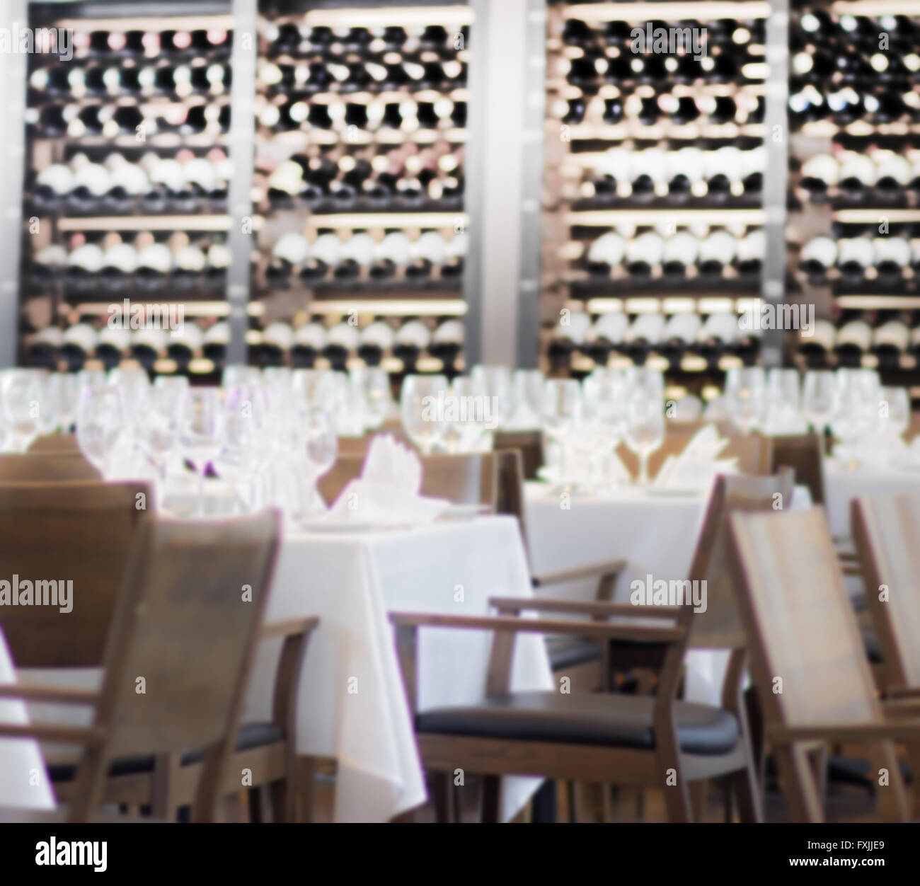 empty dining room in the restaurant unfocused - Stock Image