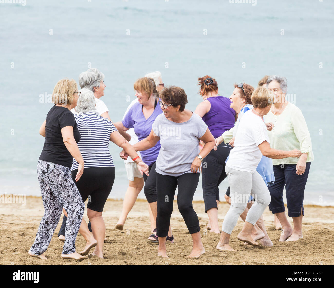 Pensioners daily keep fit class on beach. - Stock Image