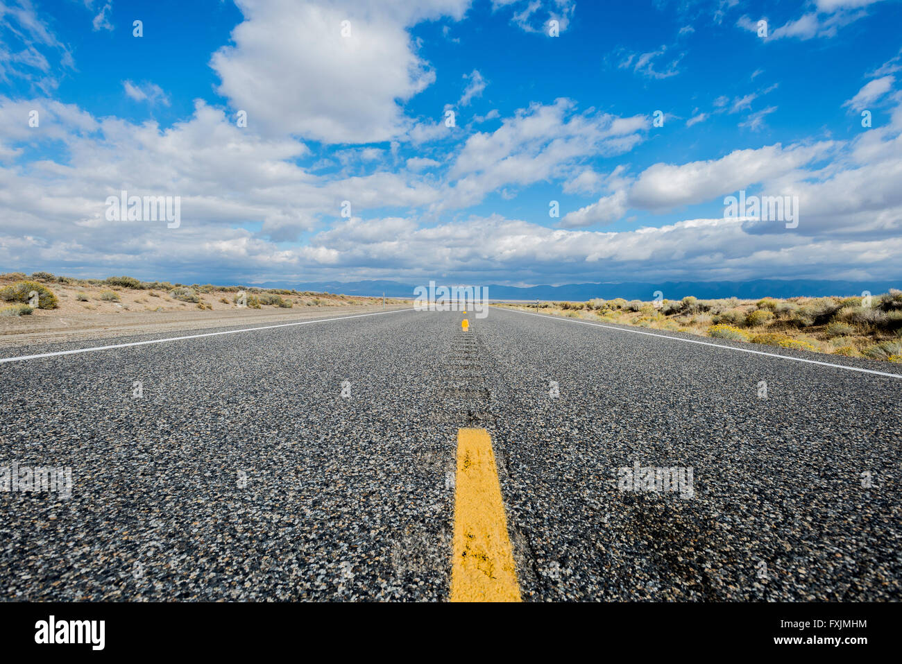 Looking down the center yellow line on Highway 50,The Loneliest Road in America, in Nevada. - Stock Image