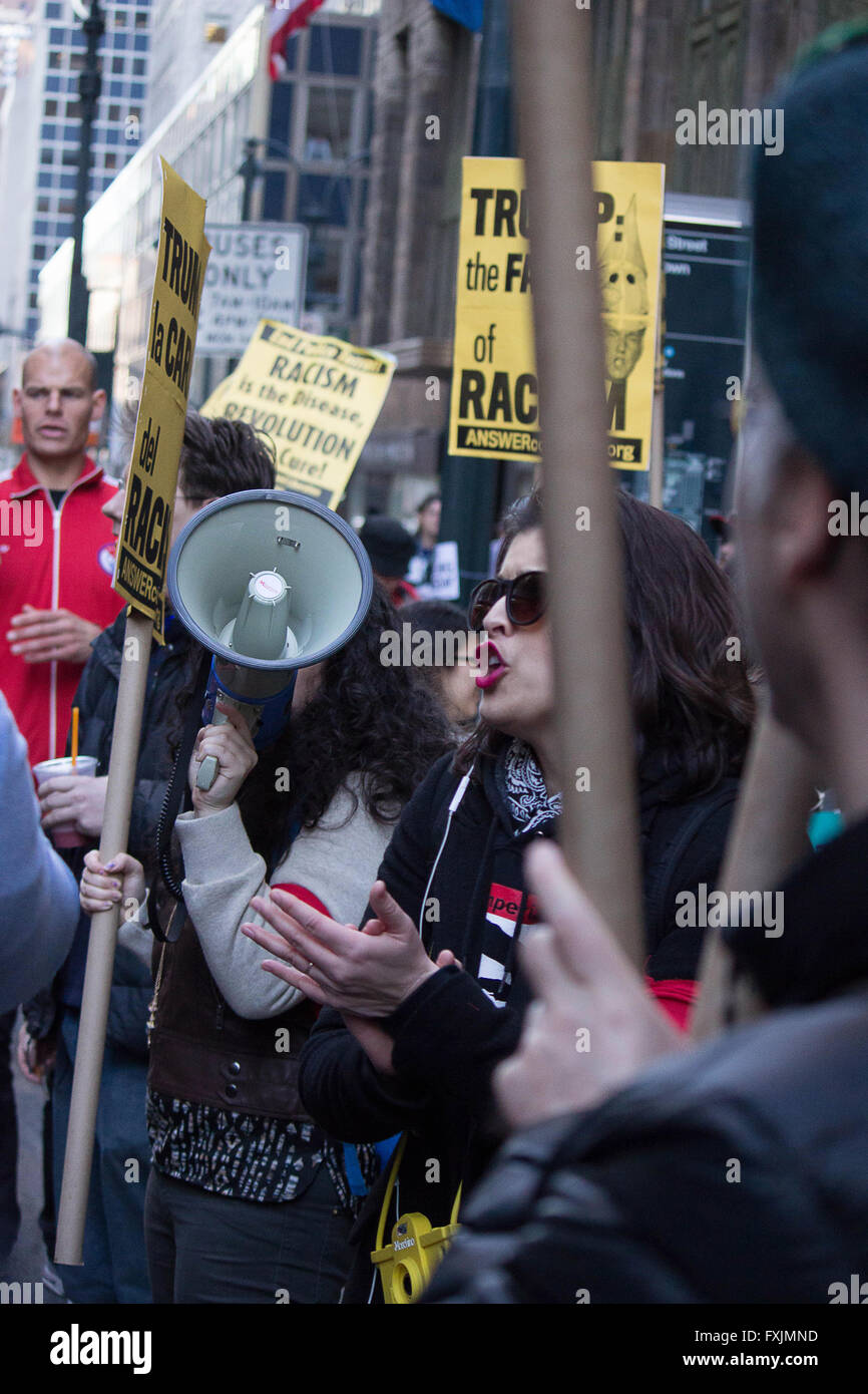 Immigrant Workers- A young Hispanic lady speaks out in support of immigrant laborers during an anti-Trump rally - Stock Image