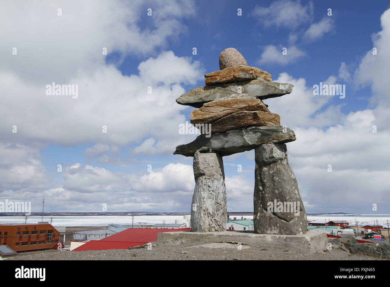 Inukshuk (or Inuksuk) at top of the hill in the community of Rankin Inlet, Nunavut near Hudson Bay, Canada Stock Photo