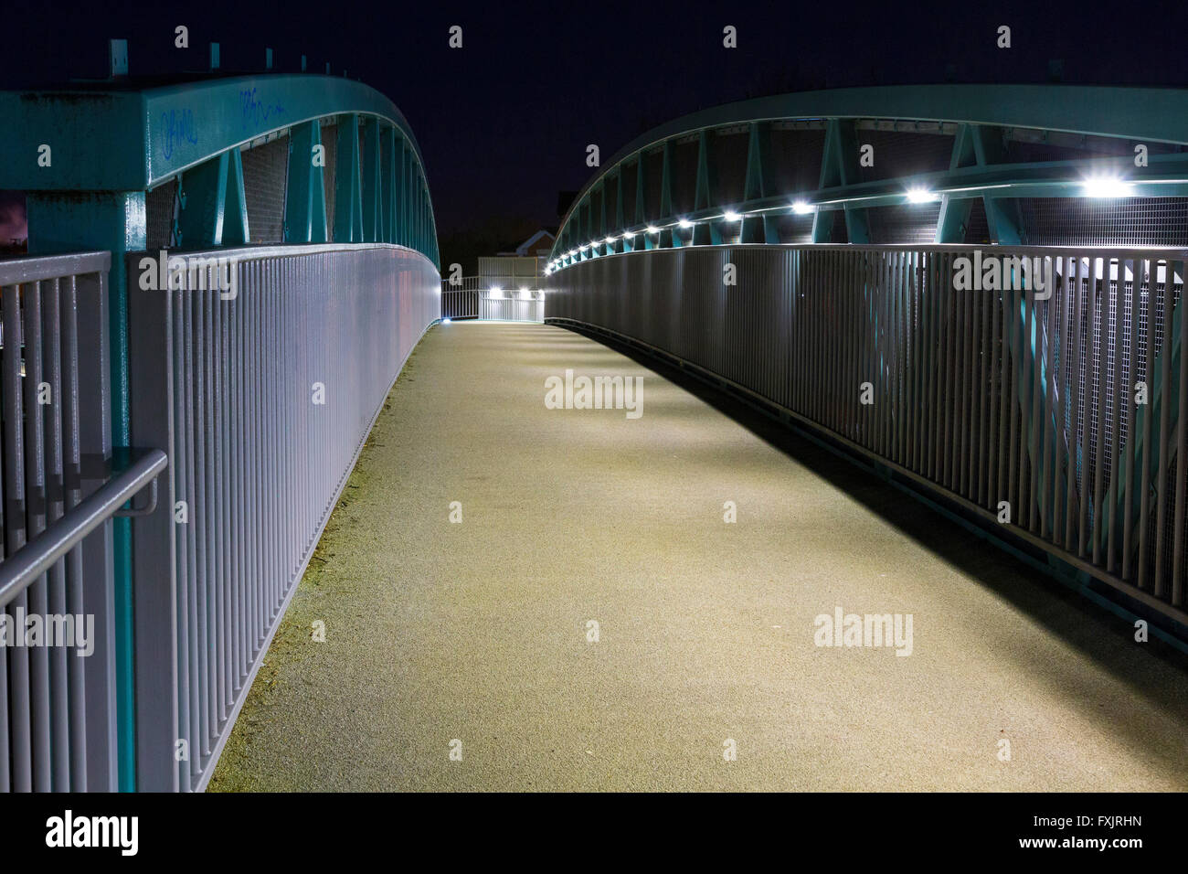 footbridge walkway at night - Stock Image
