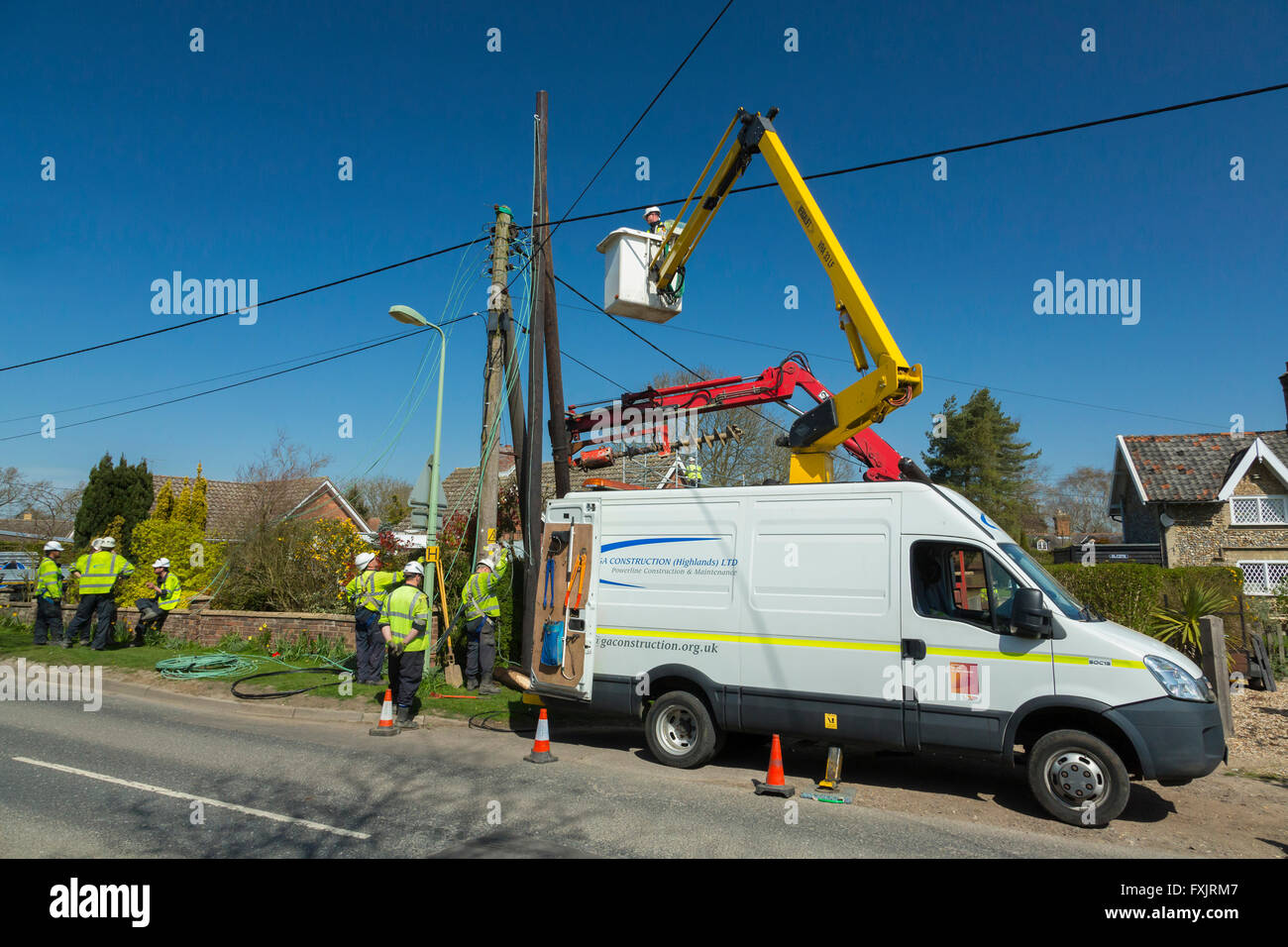 engineers working on electricity supply pole - Stock Image