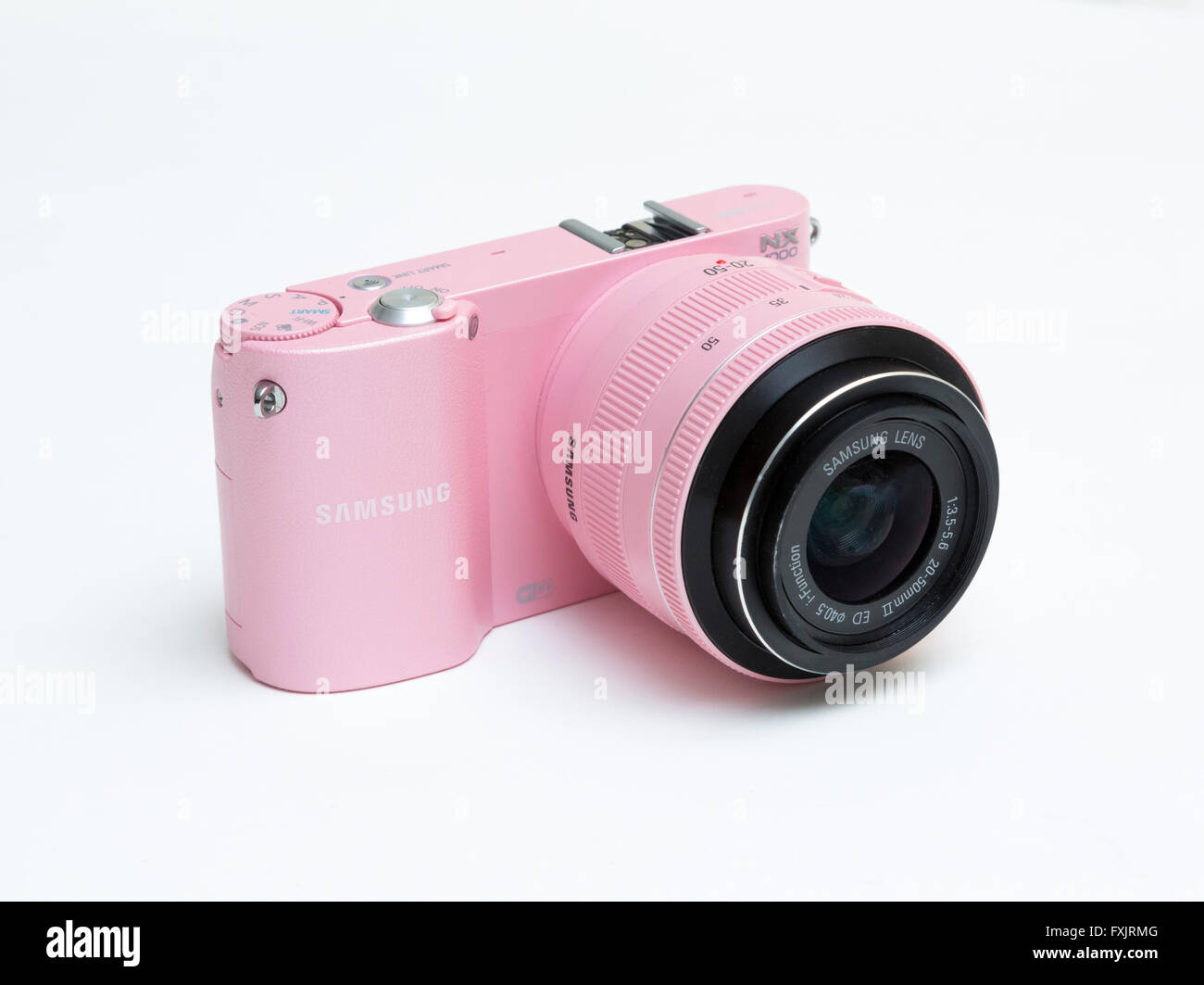 pink Samsung digital camera - Stock Image