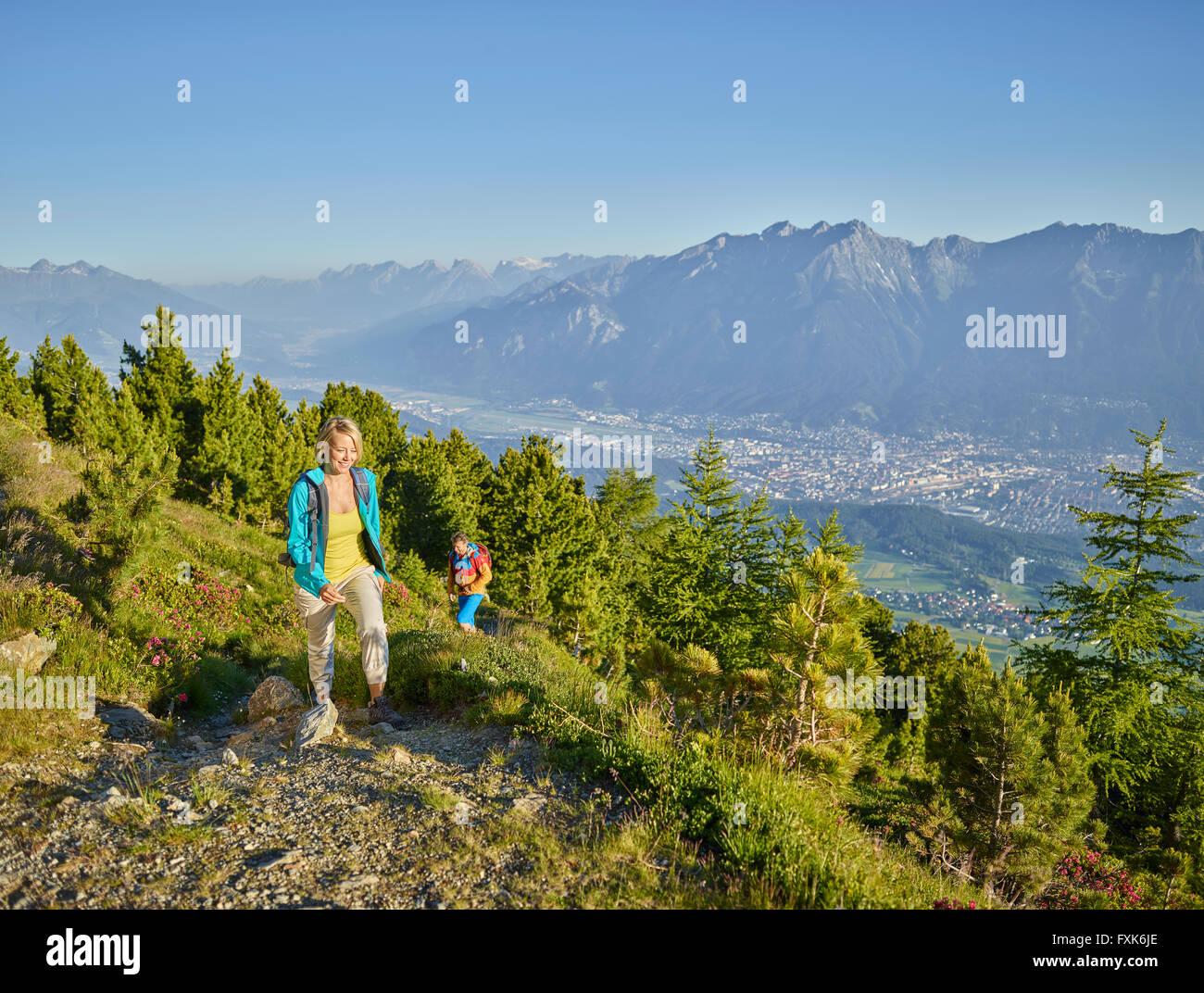 Woman 35-40 years and man 40-45 years hiking, Zirbenweg, Patscherkofel, Innsbruck, Tyrol, Austria Stock Photo