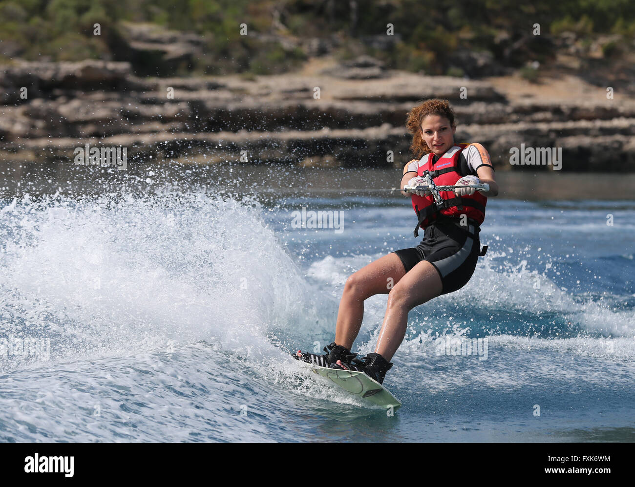 Young woman wakeboarding, Camyuva, Antalya Province, Turkey - Stock Image