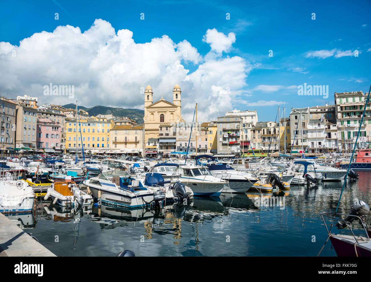 Old port with boats, Vieux port, Port de Plaisance, marina with the church Saint Jean Baptiste, Bastia, Haute-Corse, - Stock Image