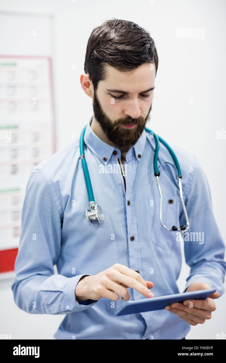 Doctor using digital tablet - Stock Image