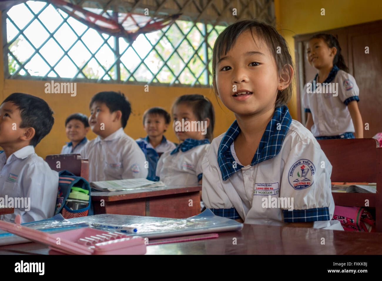 School children in school uniform learning in a small village school on the Mekong Delta, Vietnam - Stock Image