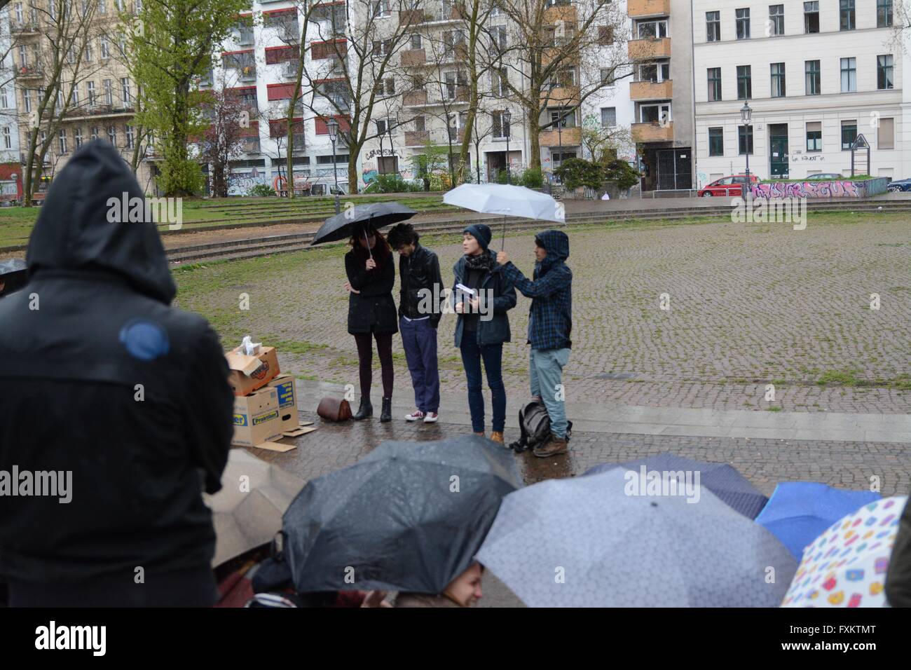 Berlin, Germany. 16th April 2016. Speakers and organisers address tghe crowd as the weather eases off. Credit:  - Stock Image