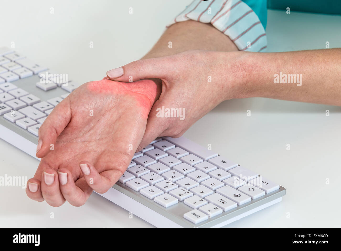 Wrist pain from working with computer,Carpal tunnel syndrome - Stock Image
