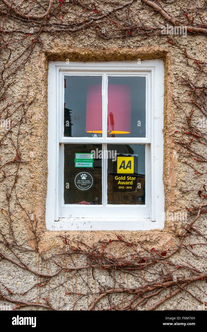 Pub Window displaying AA Gold Star Award Sign - Stock Image