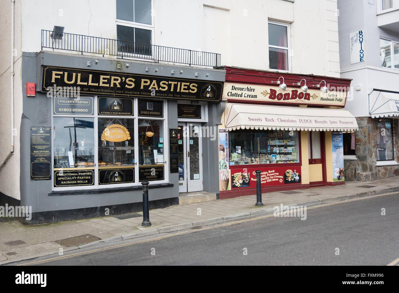 Fullers Pasties and Bon Bon sweet shop in a street in Brixham Devon UK - Stock Image