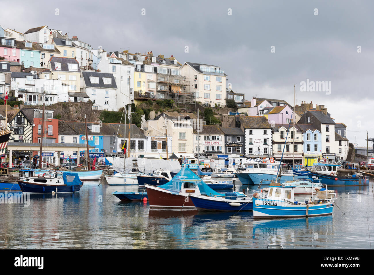 Fishing boats moored in the harbour at the fishing port of Brixham Devon UK - Stock Image