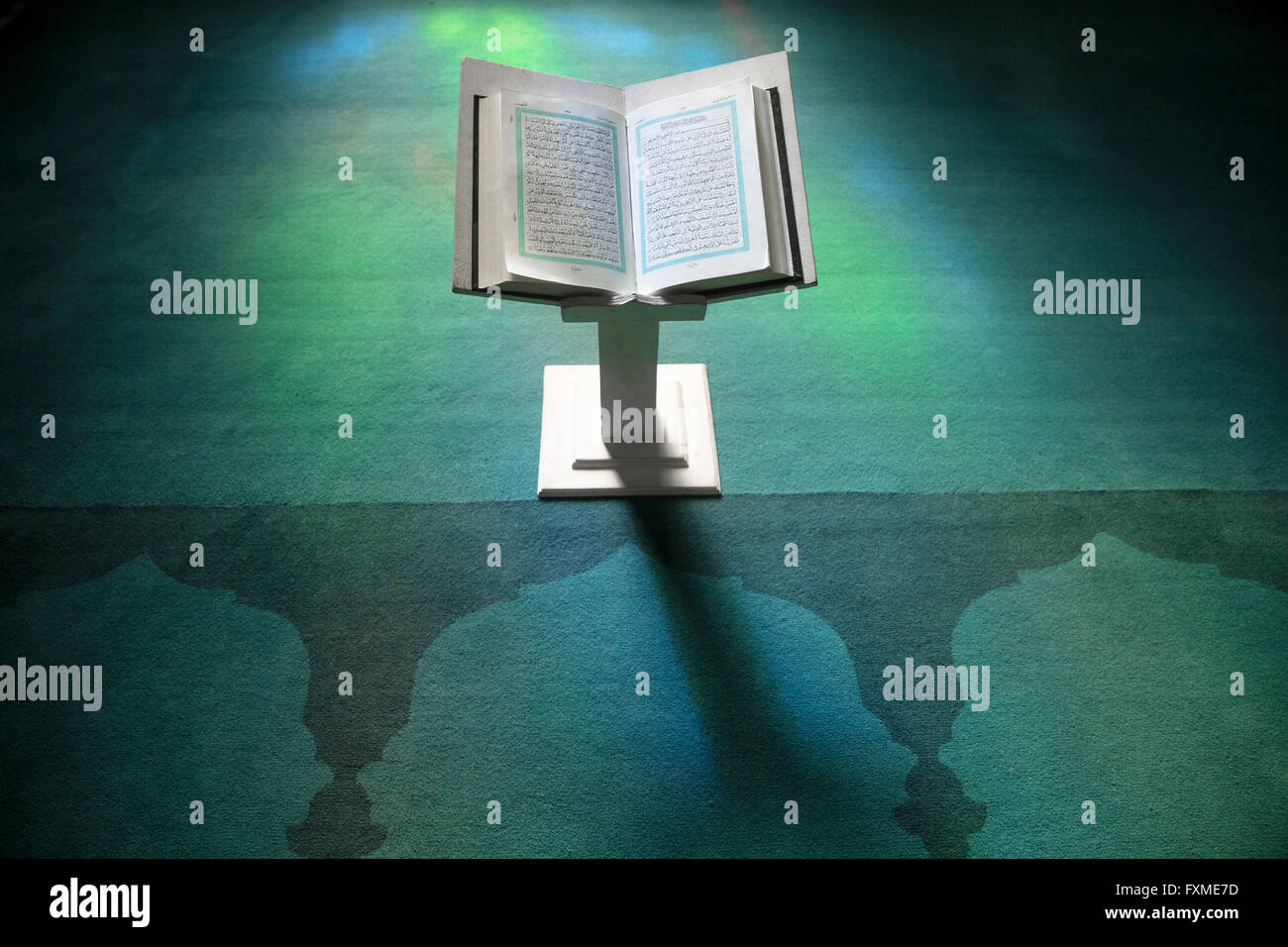 The sacred book of Muslims - the Koran is on the stand in the mosque during prayer - Stock Image